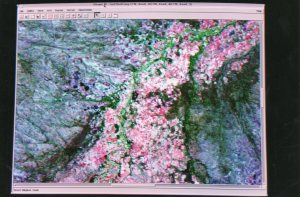 Image of Busi Valley - pink is farming, purple and greens natural vegetation